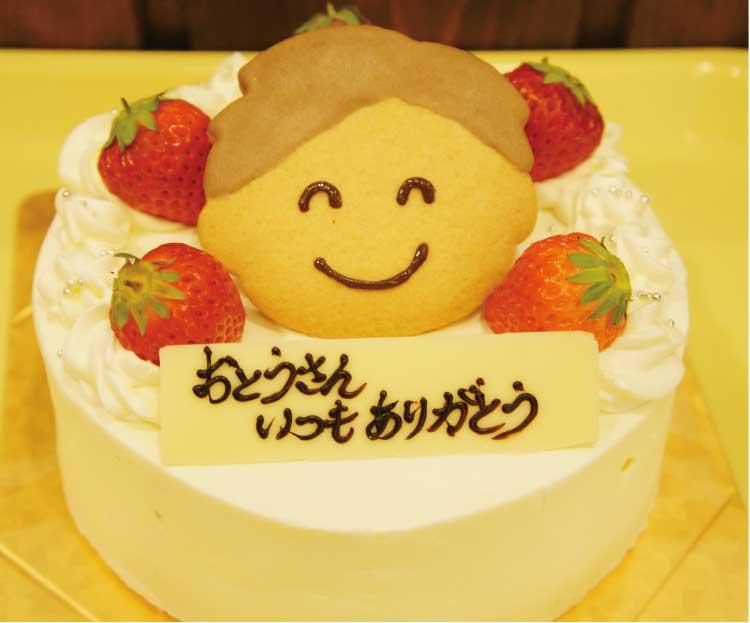 ジョリジュワジョイスのデコレーションケーキに似顔絵クッキーをのせて